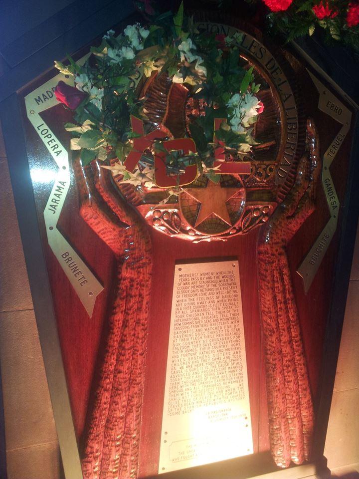 The wreath alongside the memorial plaque